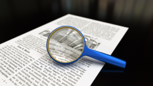 1024px-Magnifying_glass_with_focus_on_glass.png